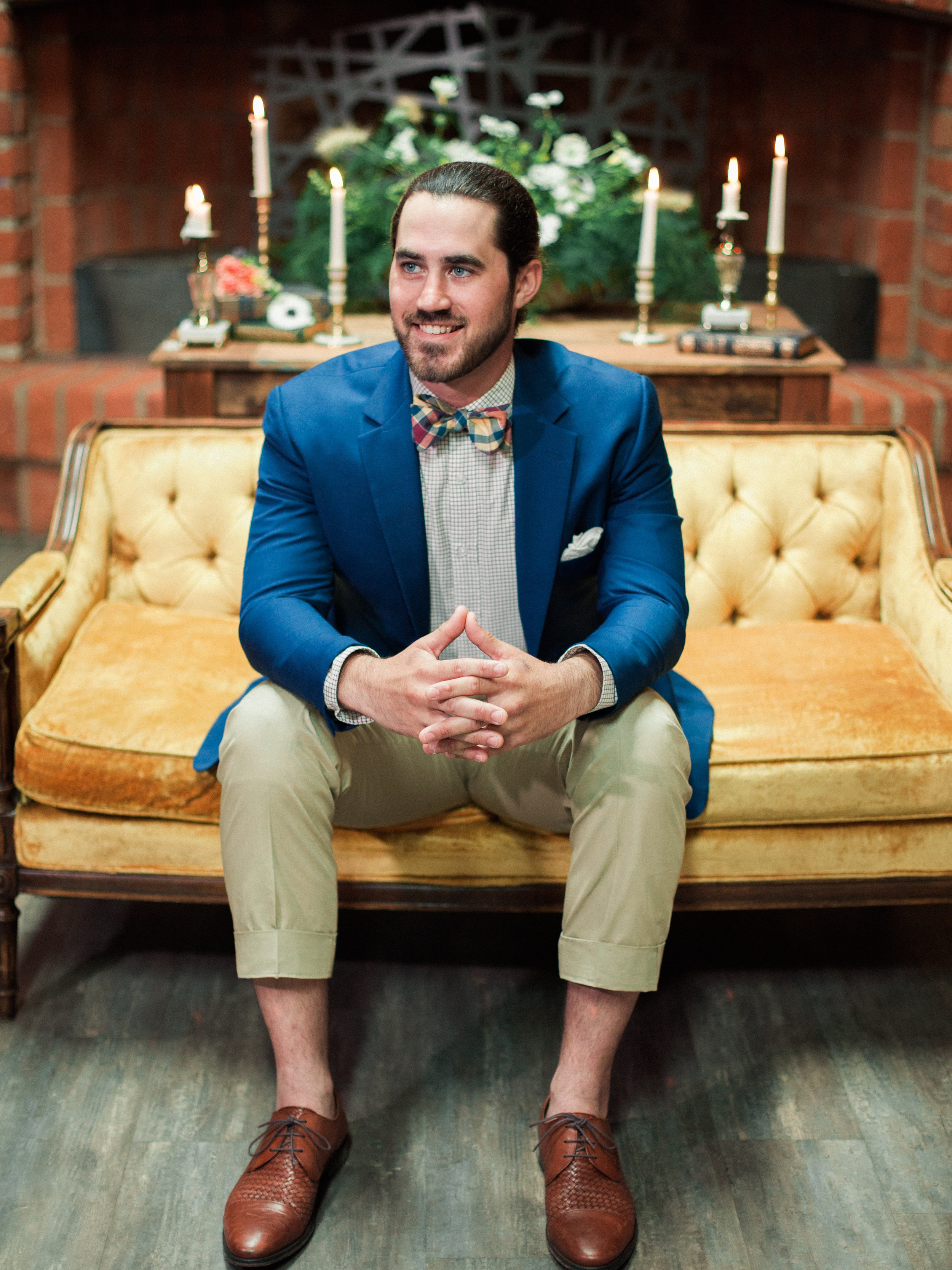 The groom sits for a photo shoot before his wedding in The Commons.