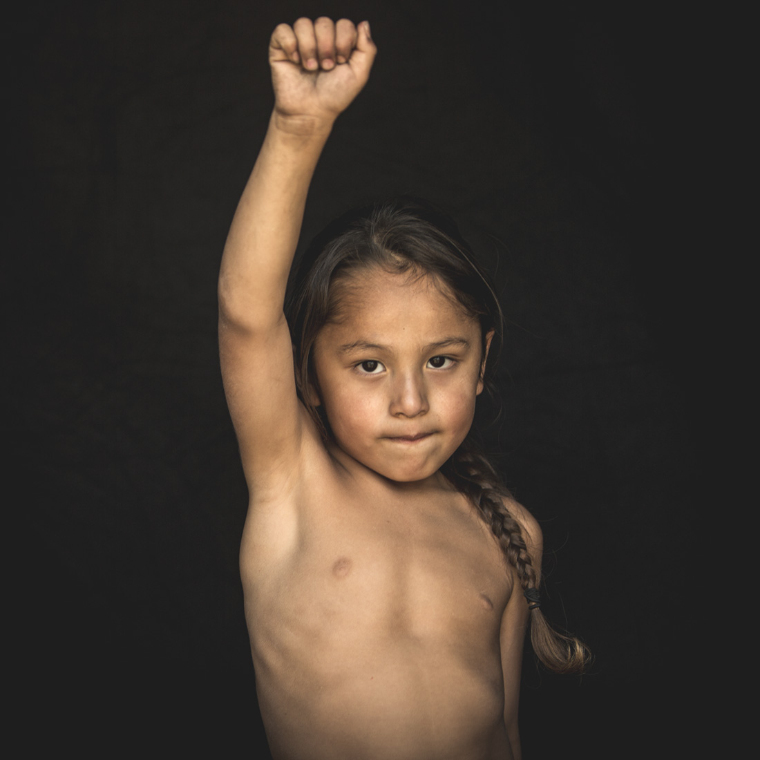 A young boy exhibits the pride and resolve of his Native people at the Standing Rock Reservation in Cannon Ball, North Dakota.