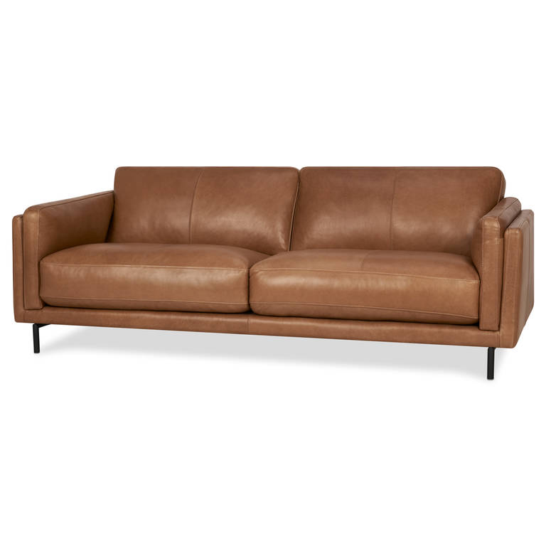 """Renfrew Sofa - Fit for a condo, this beautiful leather couch will have you and your guests saying """"Ooh la la"""" with every glance. It's modern, streamlined design in combination with its plump cushions means the Renfrew will keep your space open and fresh-looking."""
