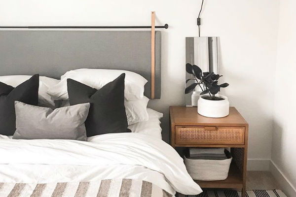 Keep things modern and minimal with design inspiration from  @kristenforgione . This headboard is hung from contrasting leather straps to keep your bedroom aesthetic chic and clean.