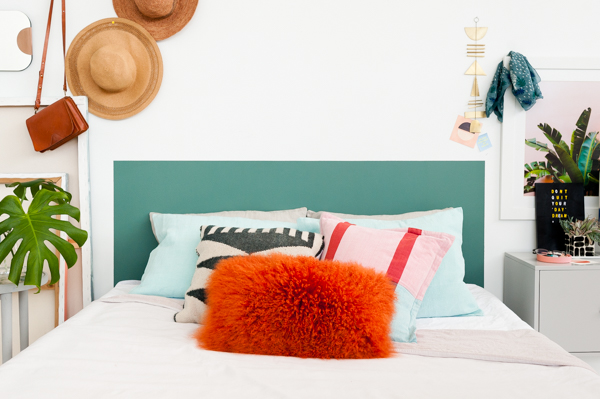 This clever headboard idea from Paper & Stitch  doesn't require a whack-load of supplies to give your bedroom a design boost. No need for building – just paint it!