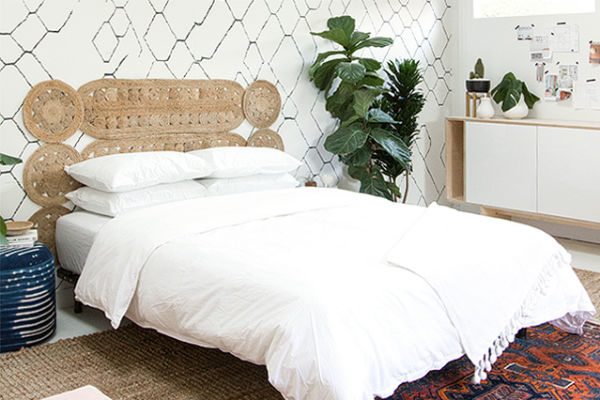 Here's another boho inspired headboard that's also very easy to put together by  Sarah Sherman Samuel . It's eye-catching, unique, and totally welcoming.