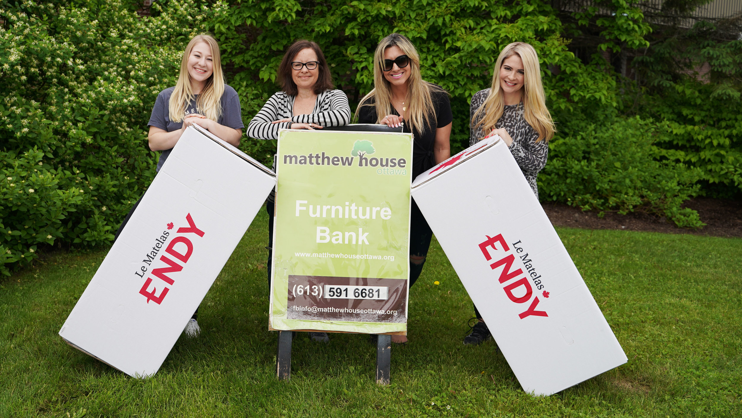Left to right: Vicki Dignard, Fran Laurendeau, Loukia Zigoumis, and Melissa Lamb spend their day volunteering with Endy Canada and Matthew House Ottawa Furniture Bank.