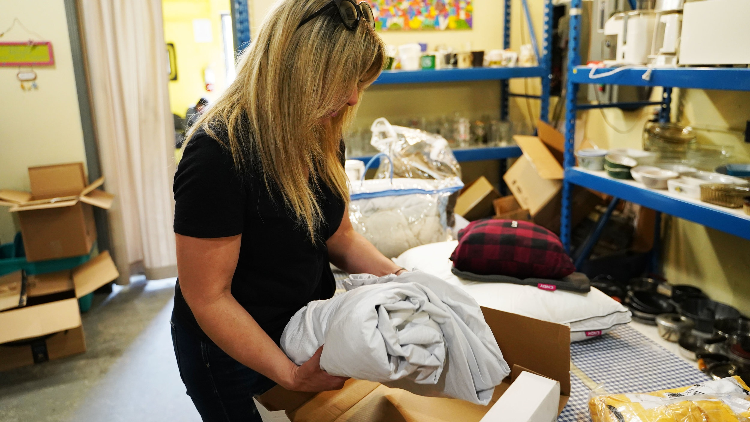 Loukia Zigoumis packaging up Endy Sheets for a family.