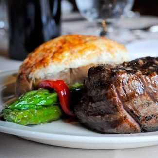 Gibby's - Eat your dinner next to a cozy fireplace in an 18th-century stable.298 Place d'Youville