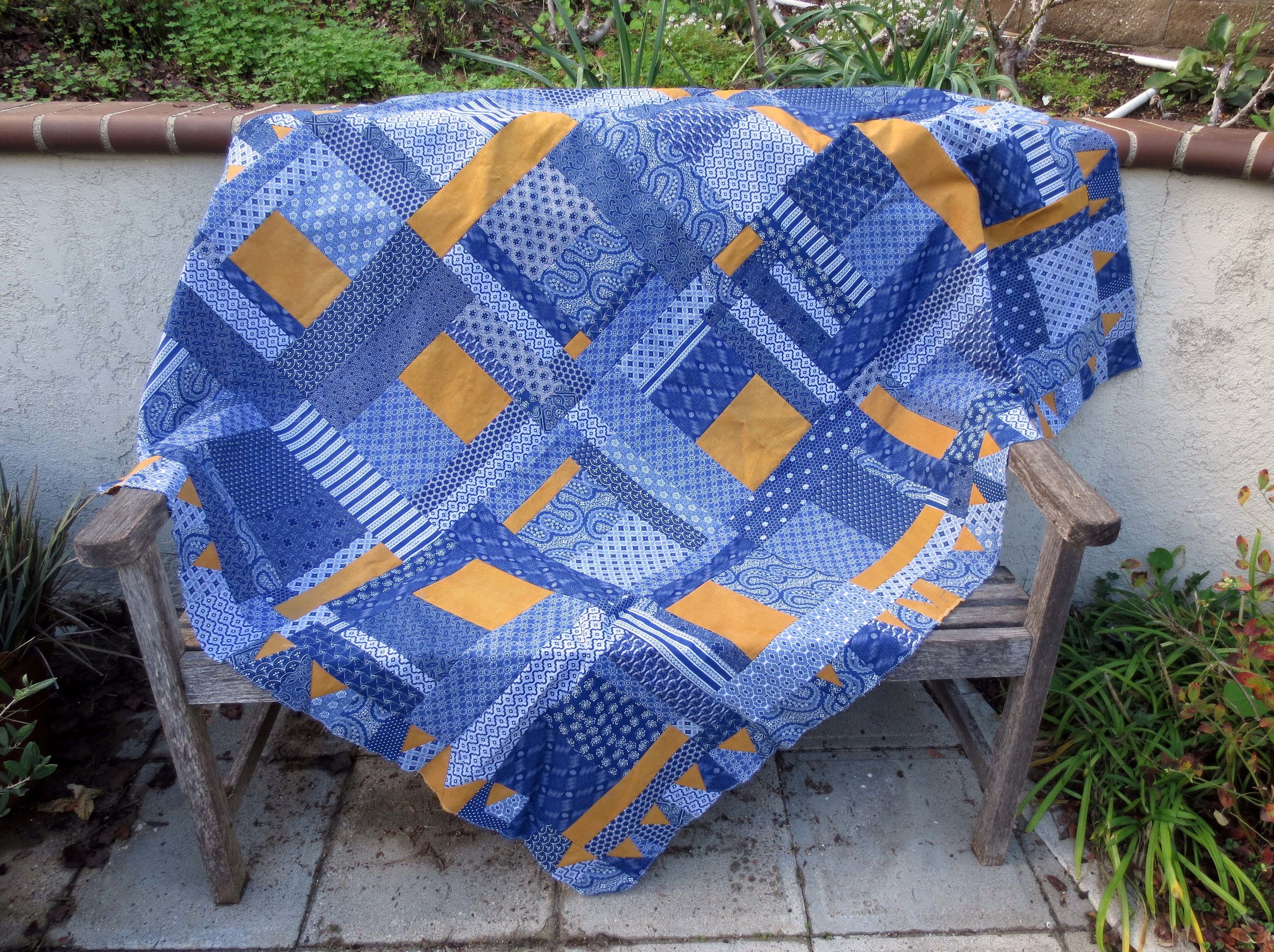 "Indigo dyed fabrics from ""Cotton in the Cabin"" with onion skin dyed accents."