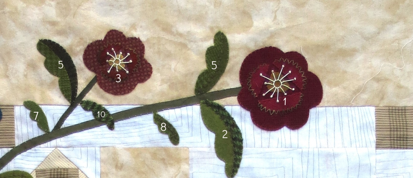 Flowers and leaves at top left side of quilt.