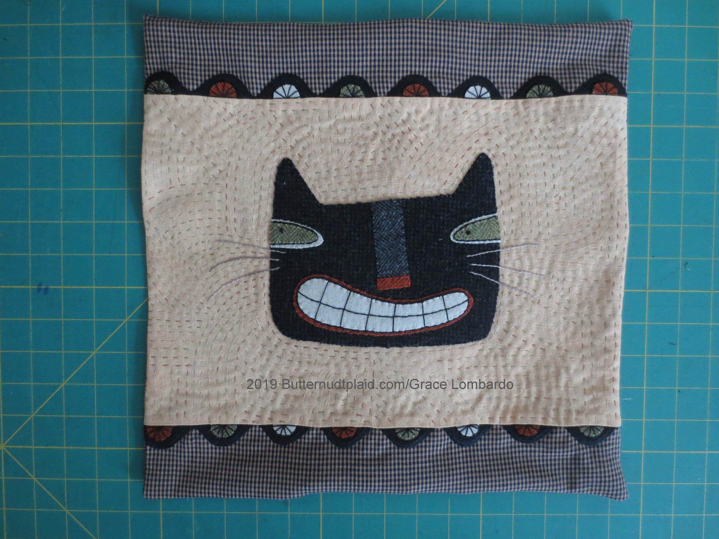 smiling cat pillow unstuffed.jpg