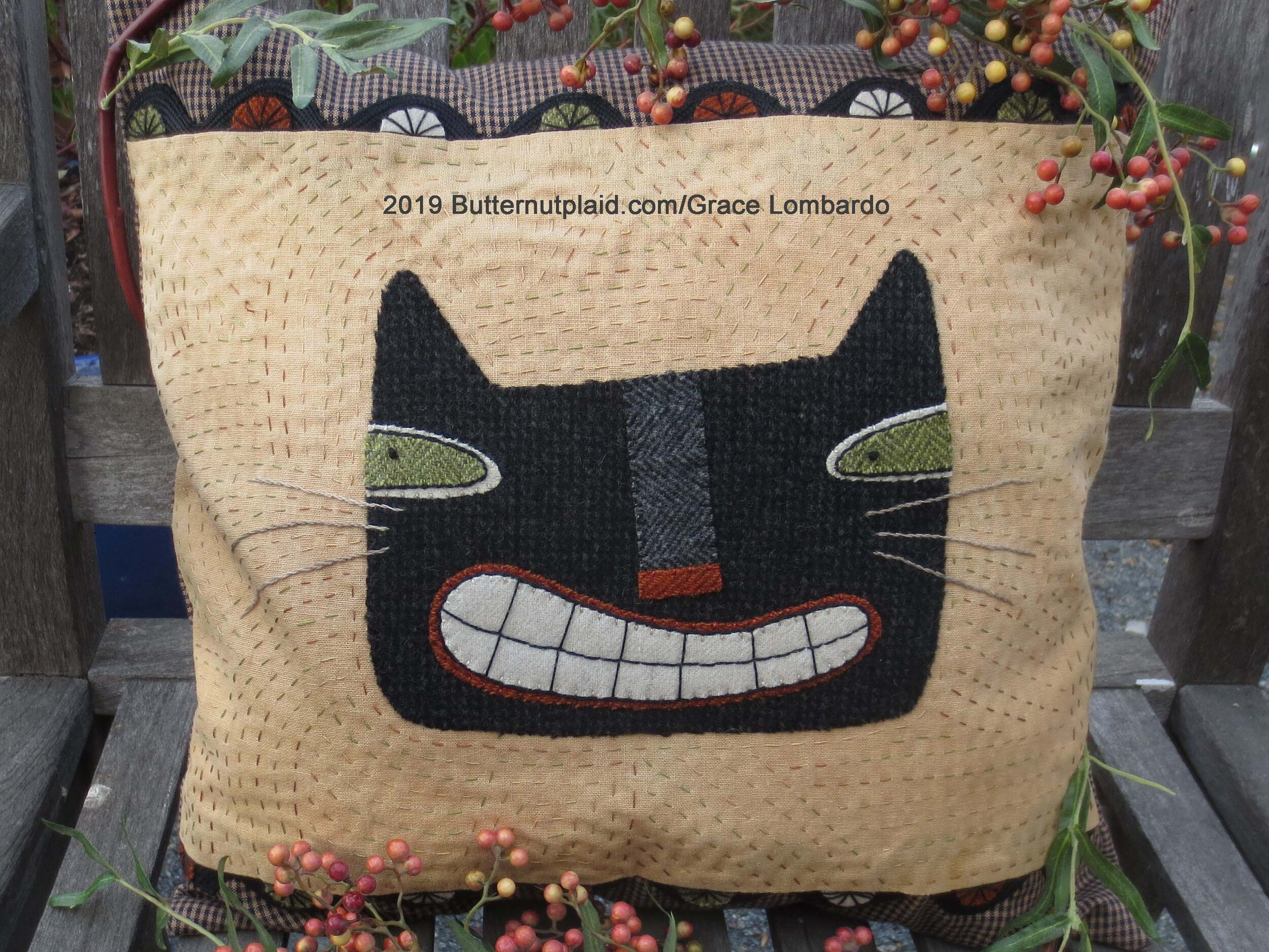 smiling cat pillow finished.jpg