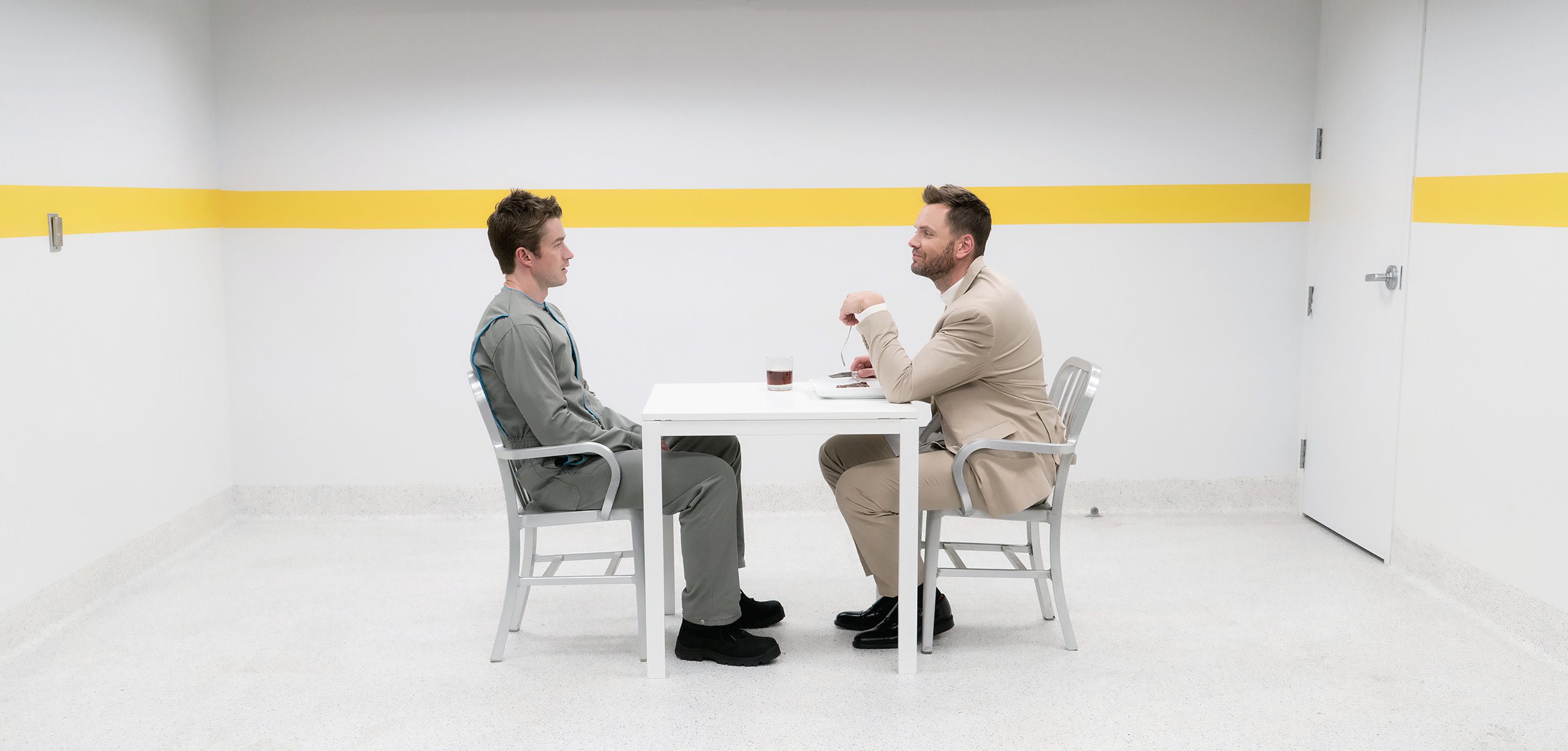 Joel McHale and Robert Buckley in a scene from Hulu's Dimension 404.