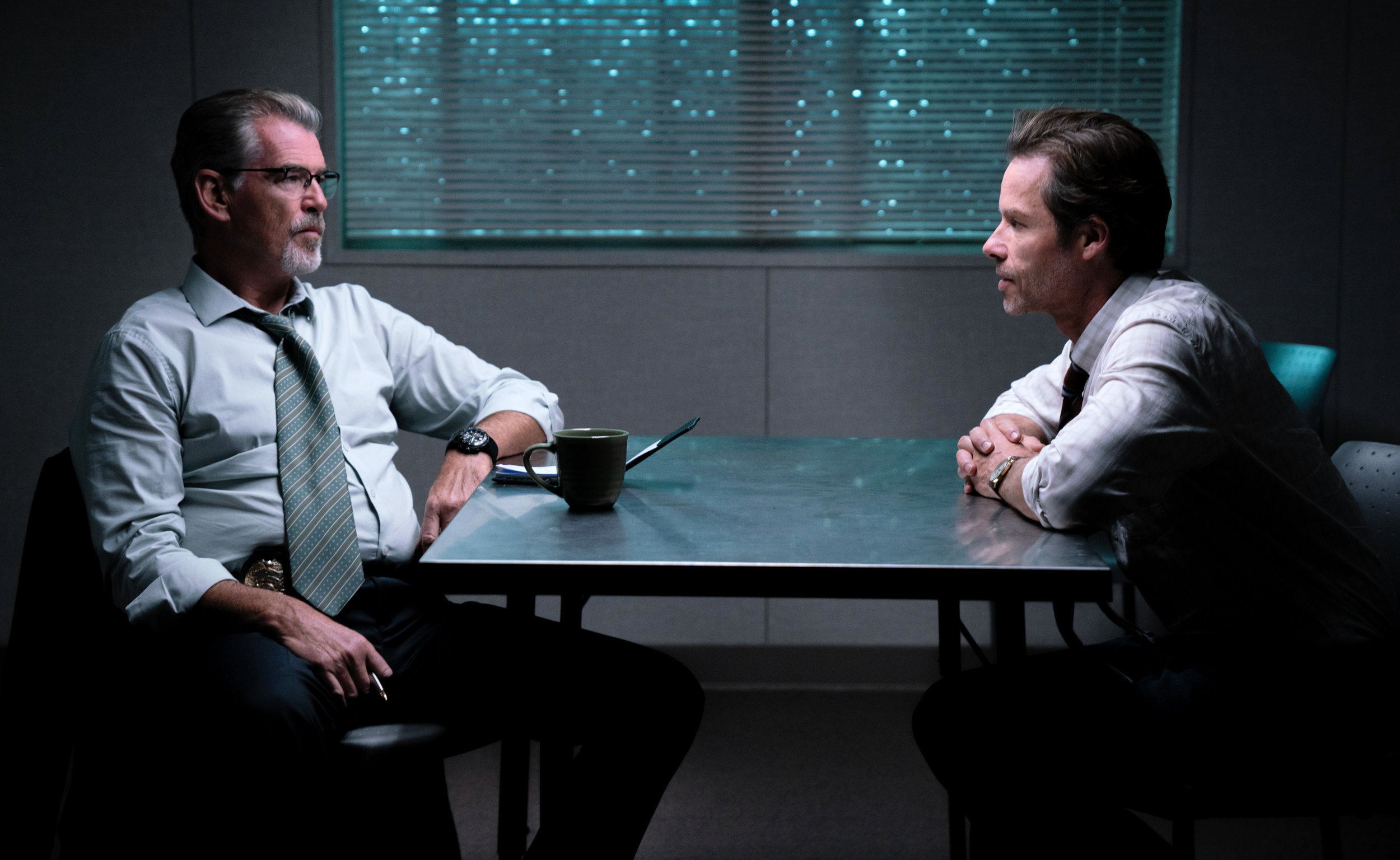 Pierce Brosnan and Guy Pearce in Spinning Man