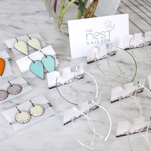 @thenestnailspa is all stocked up with @enfusejewelry and some @sounds_of_silver pieces too! A little extra sparkle and pop of color to accent those fresh nails! #ohlala #pretties