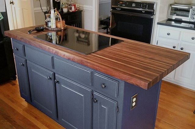 Remember that edge grain walnut counter top I was working on back in November? Here it is set in place in its final home!