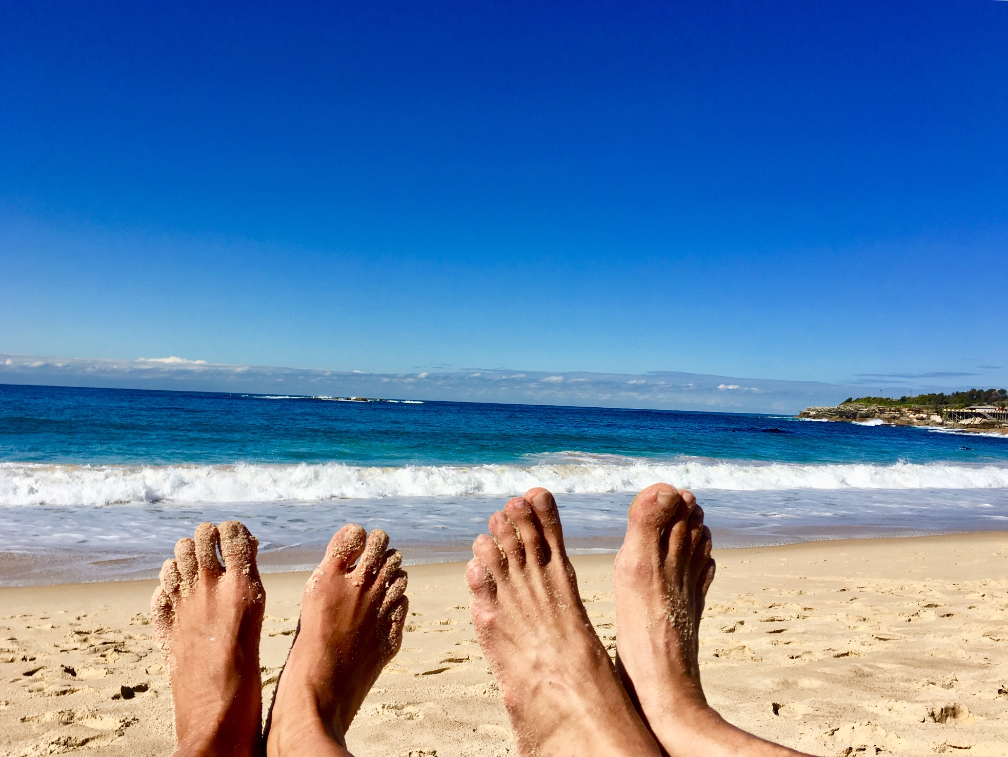 First thing first as we touch the Australian soil. Landing our bare feet on the sand and the ocean at Coogee Beach, Sydney, Australia
