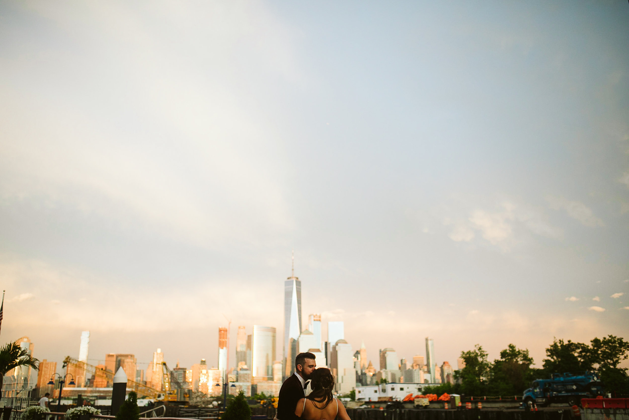 A portrait of the bride and groom with the NYC skyline behind them at this Battello Wedding in Jersey City, NJ