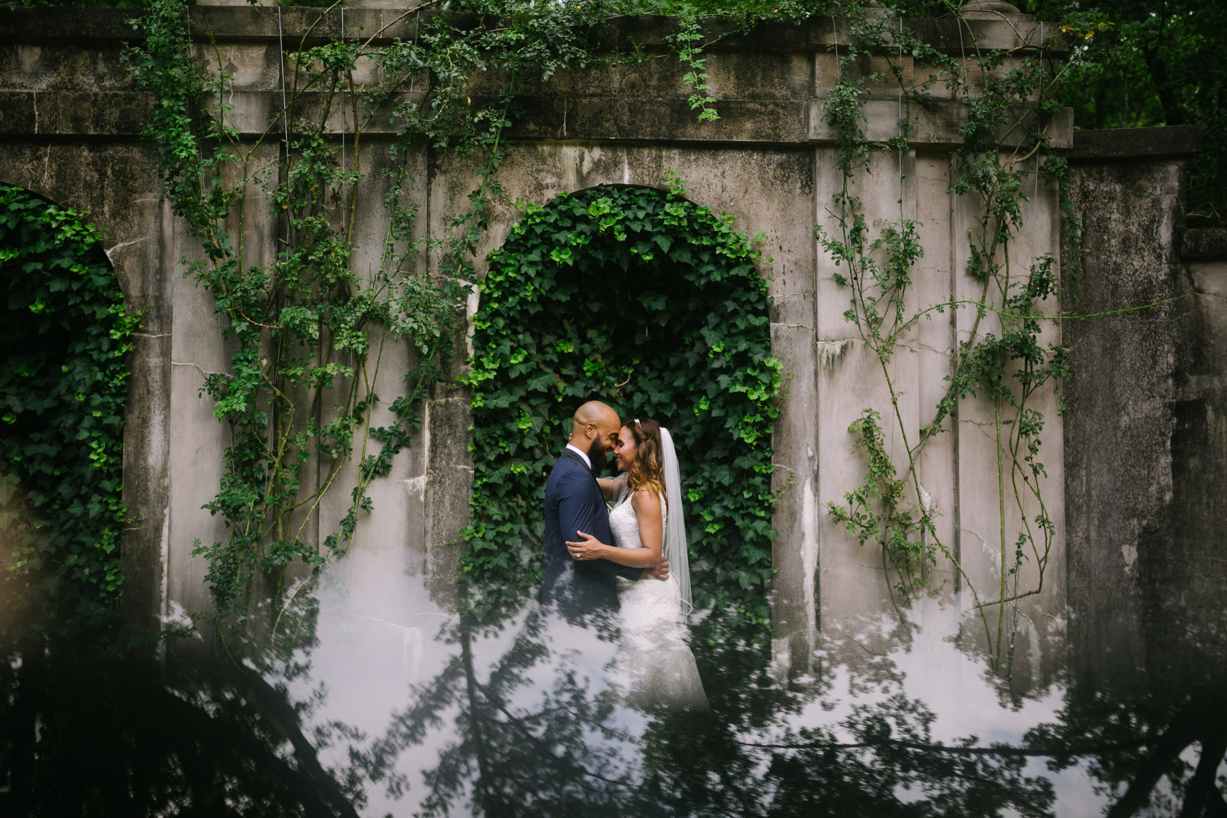 bride and groom arch and ivy wedding photo