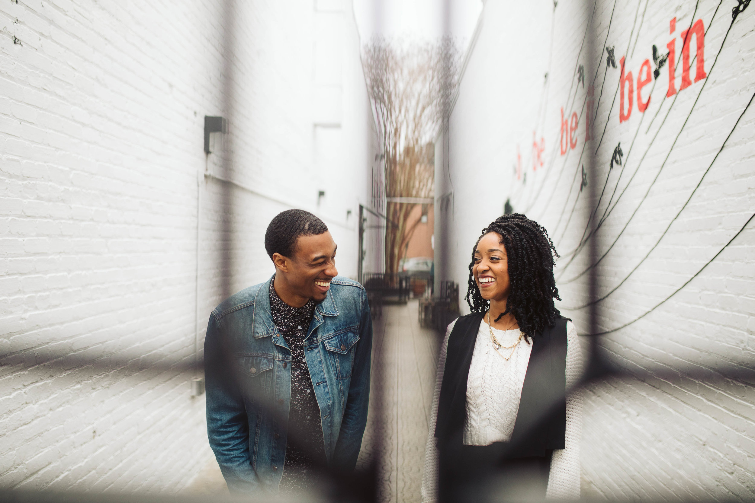 engagement shoot with couple in alley