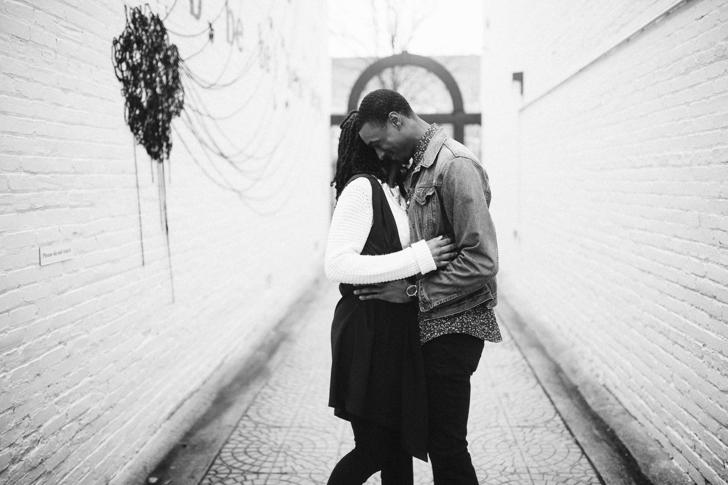 couple hugging in black and white for engagement photo