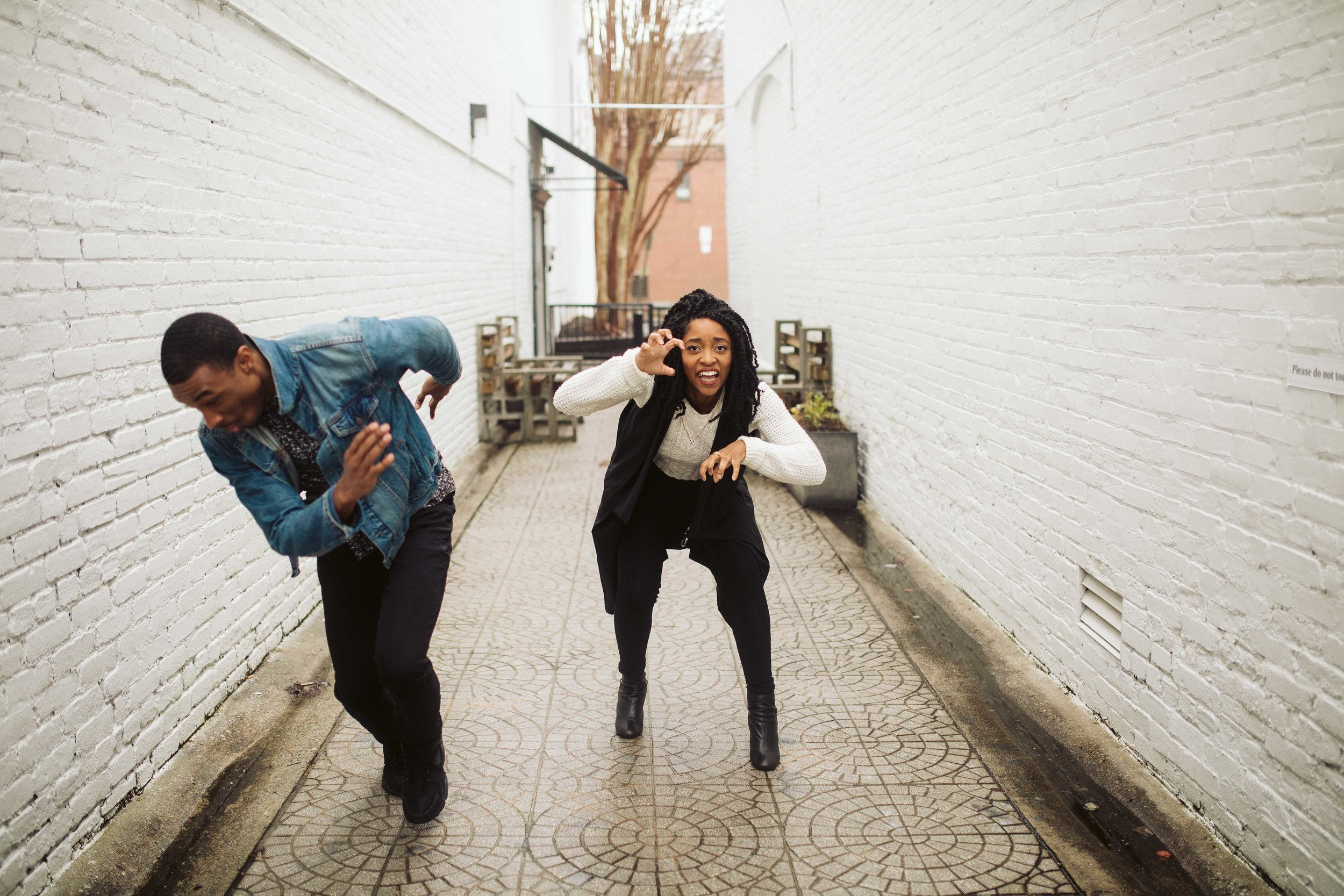 couple running and laughing for engagement photo