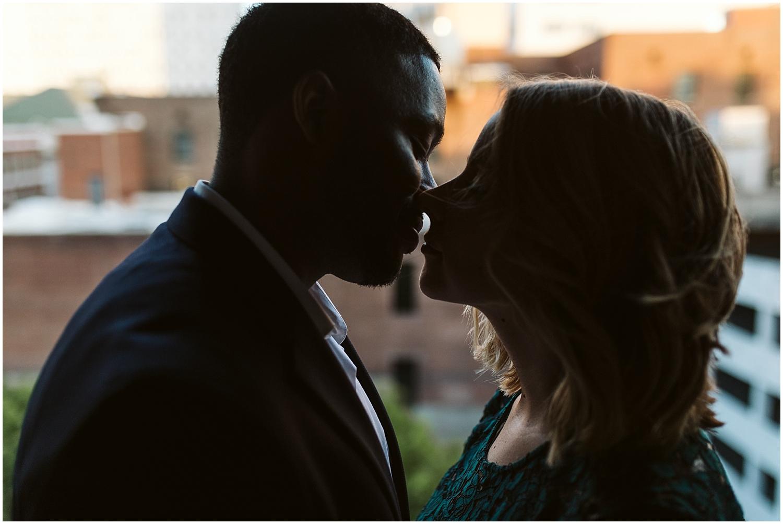 couple kissing in downtown atlanta