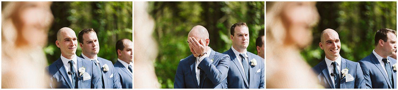 groom crying during wedding