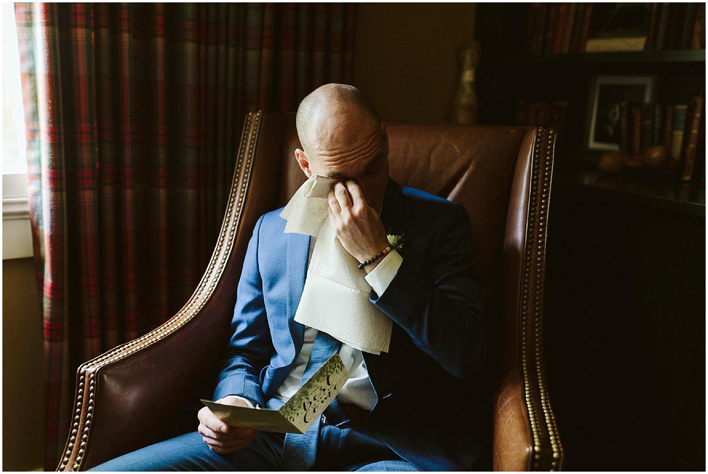 groom cries on wedding day