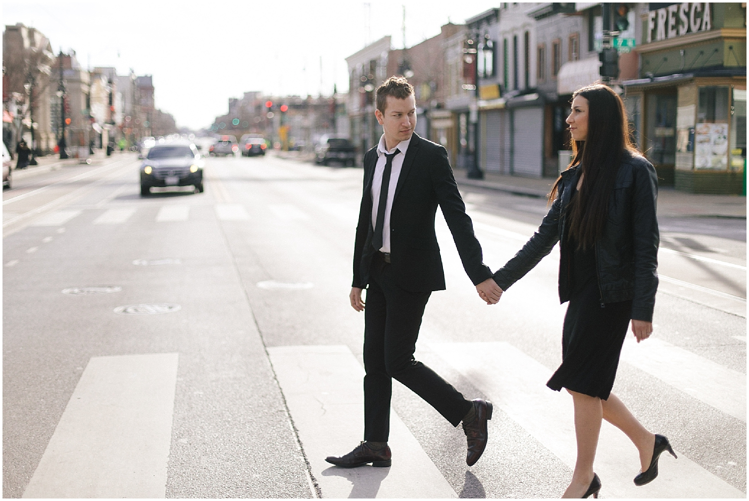 couple crossing the street in washington dc engagement shoot