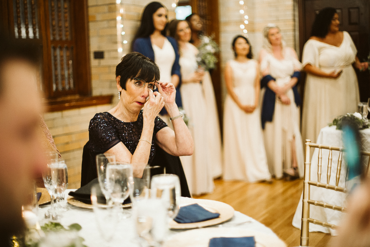 mother of the bride cries during st francis hall wedding reception