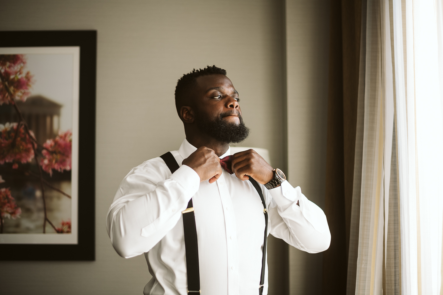 black groom getting ready for st francis hall wedding