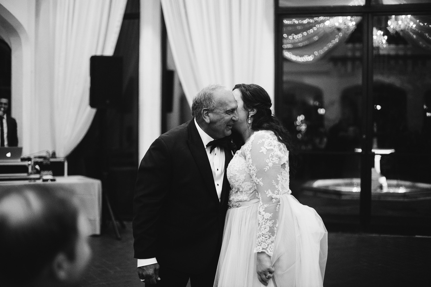 sweet moment between bride and father on wedding day