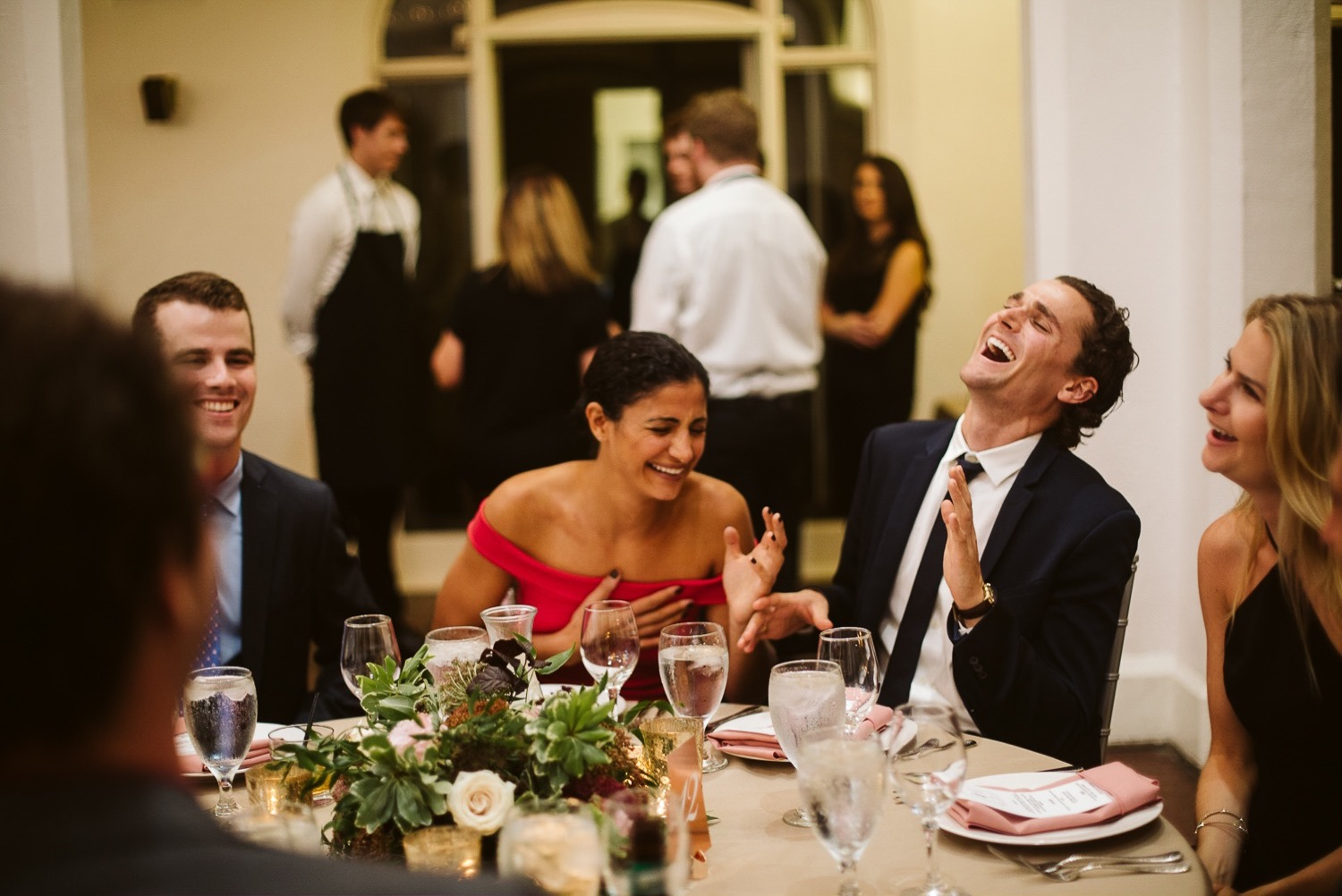 laughing guests at callanwolde fine arts center wedding reception