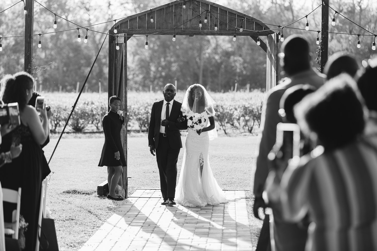 bride entering ceremony at ever after farms