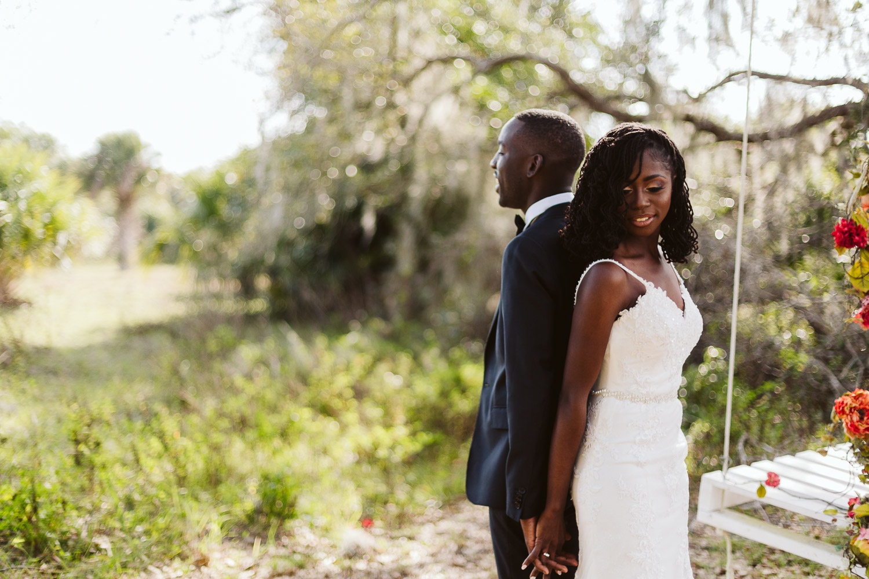 black bride and black groom first look