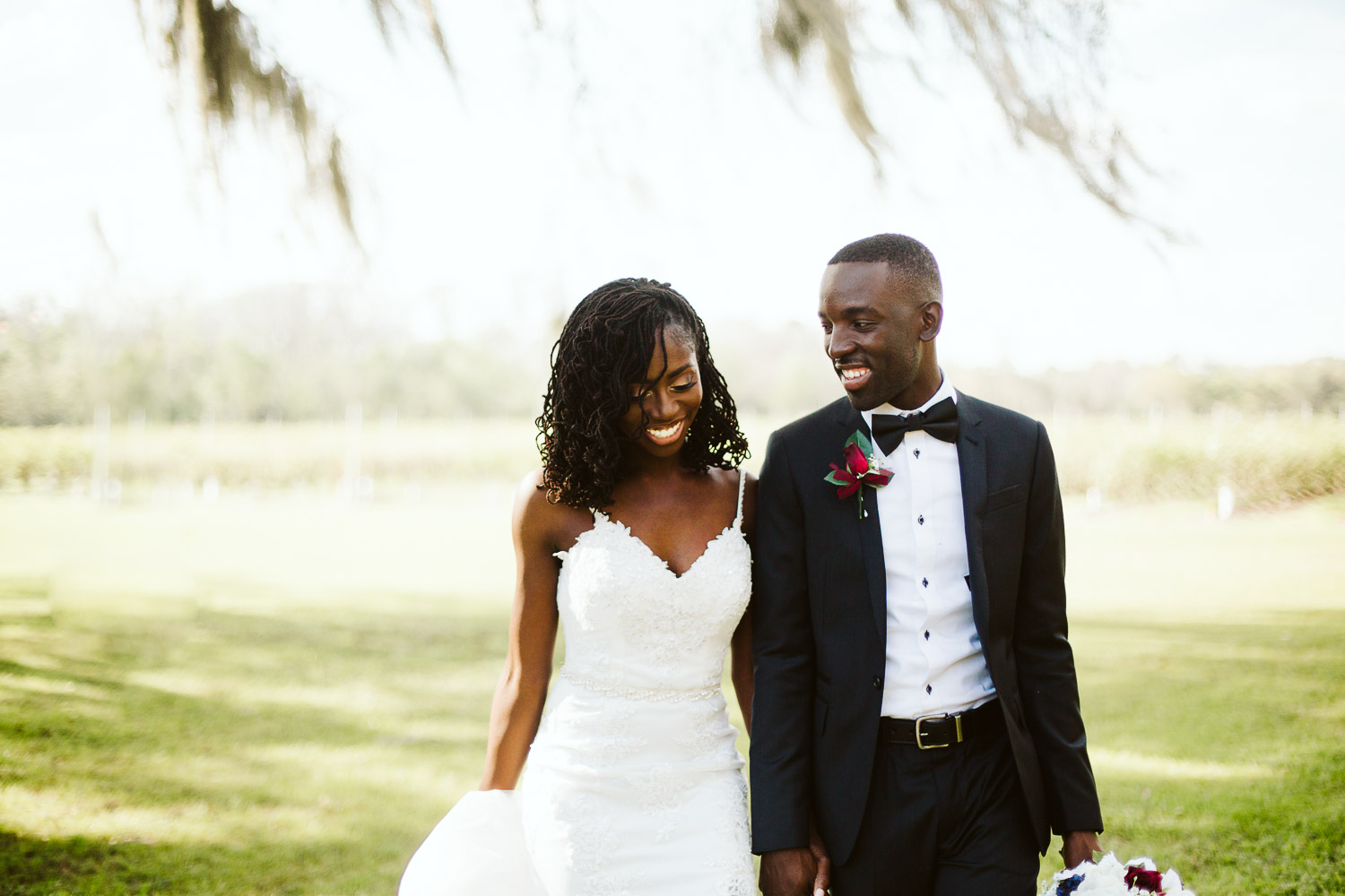 black bride with sister locs and groom