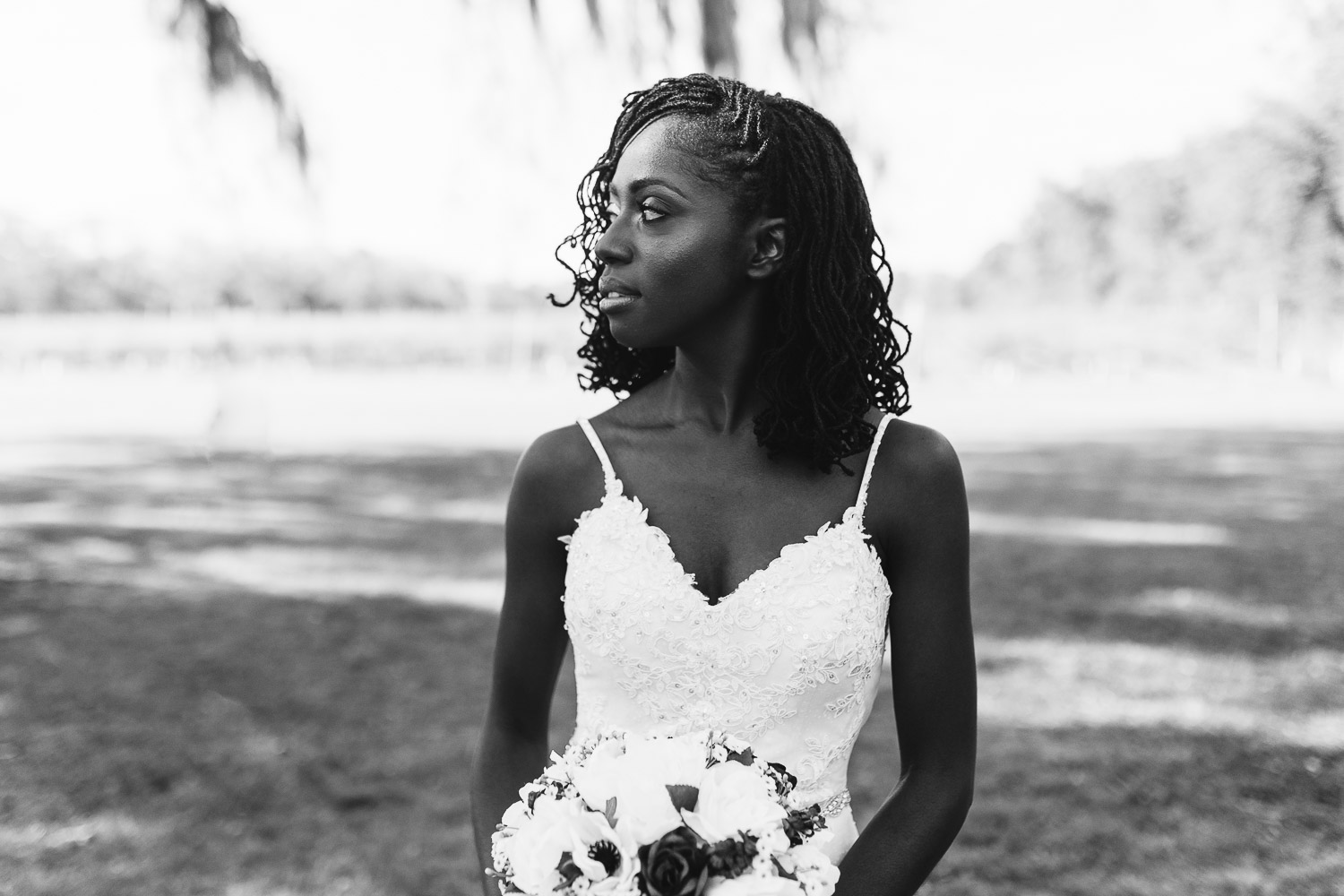 black and white photo of bride with sister locs