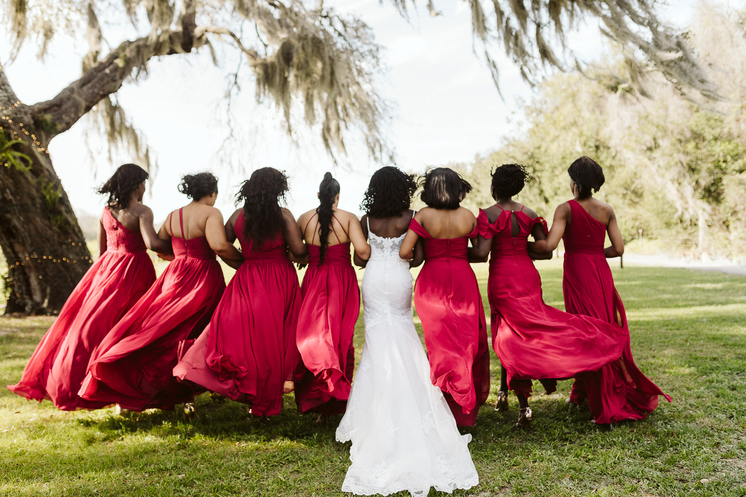 bridesmaids wearing long red dresses