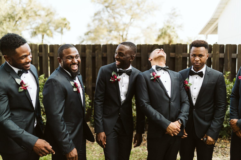 groomsmen wearing black suits
