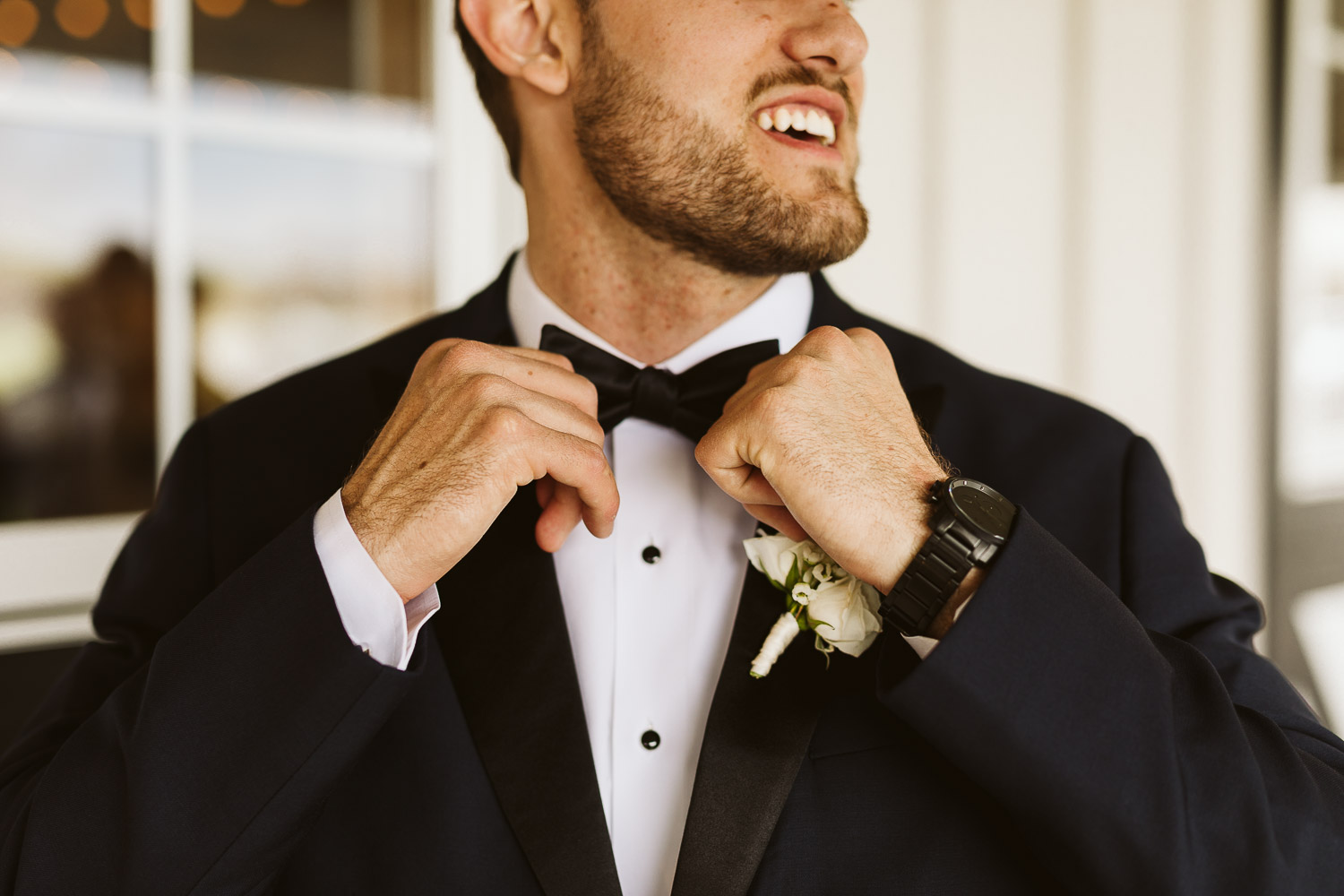groom putting on bow tie