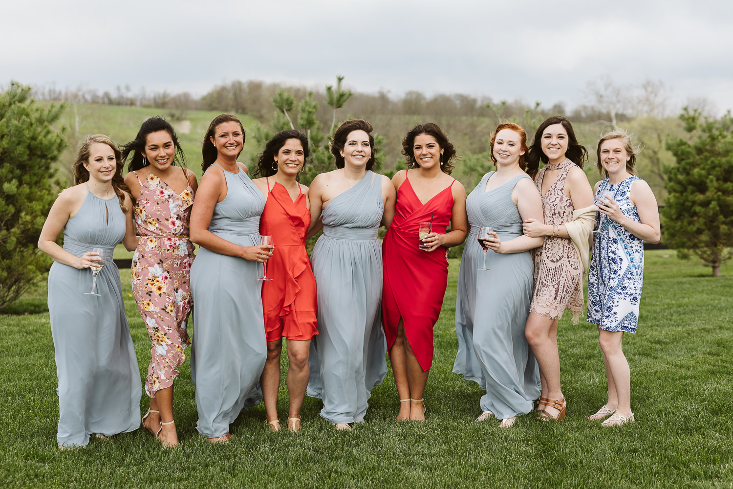 wedding guests wearing blue and coral