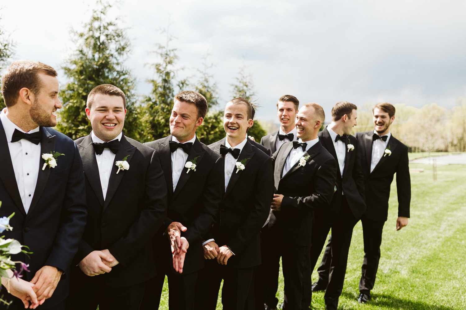 groomsmen wearing black suits outside