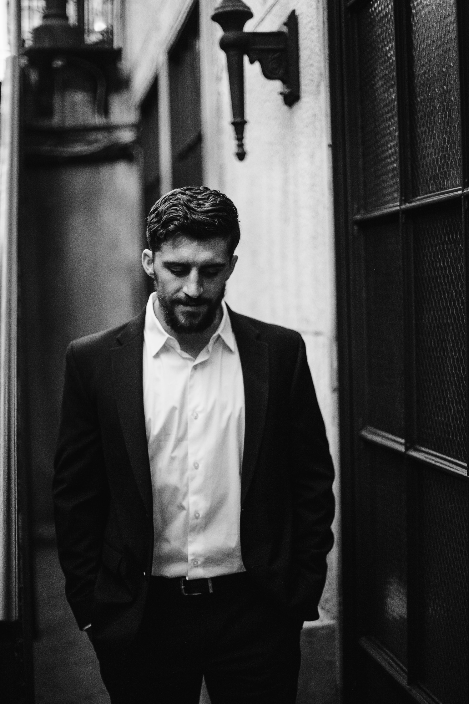 moody black and white groom photo