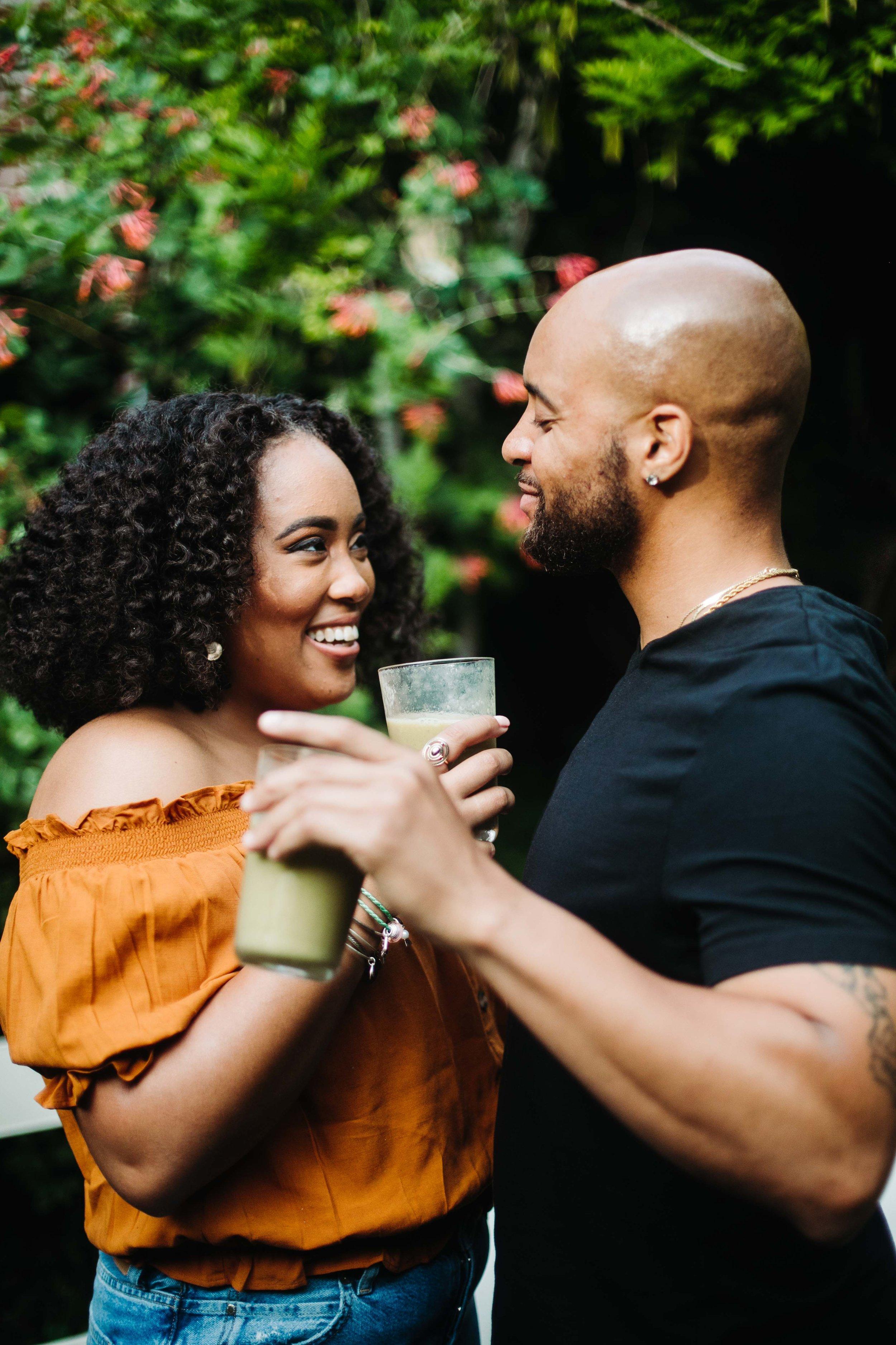 couple enjoying a green smoothie