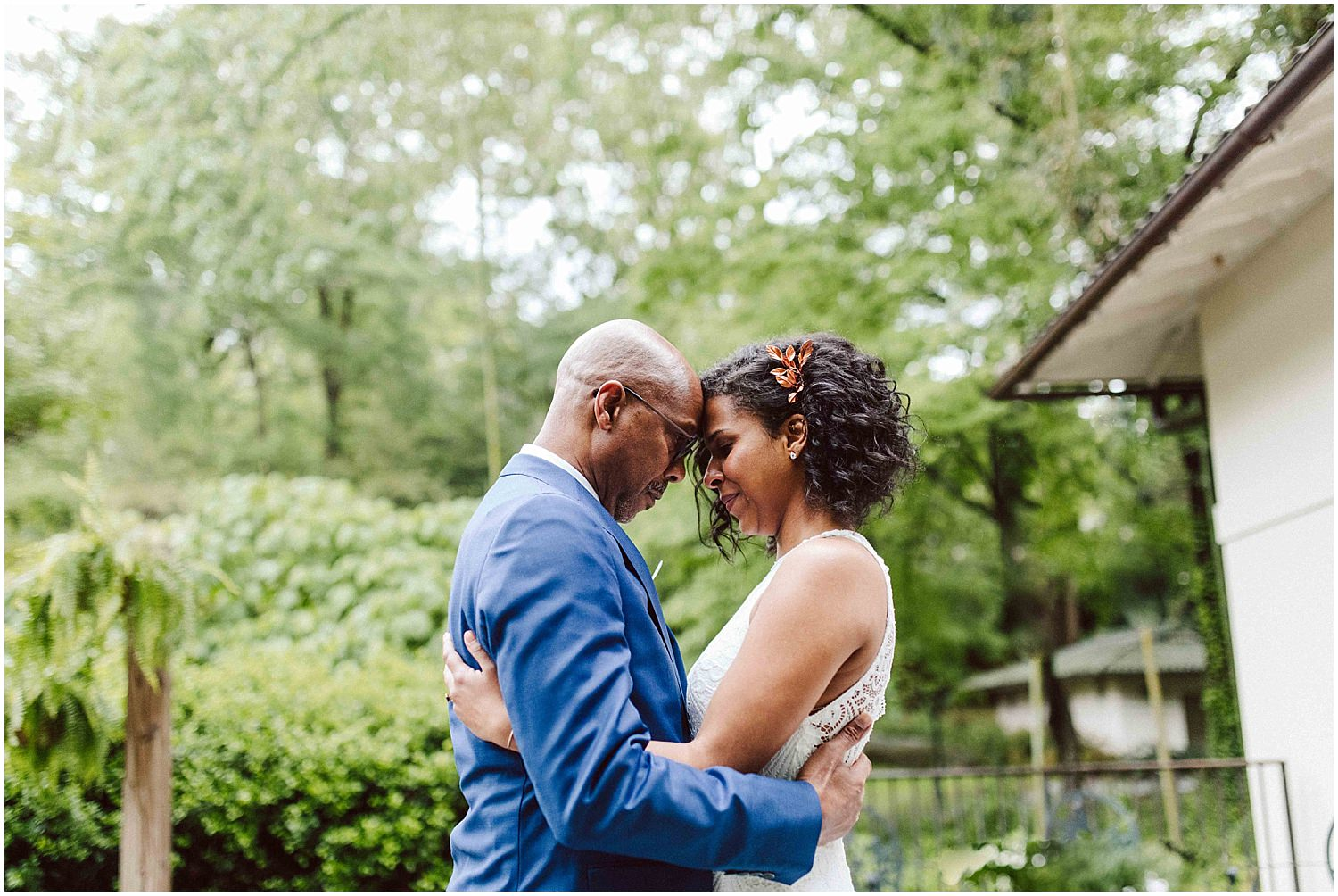 bride and father cry during first look on wedding day