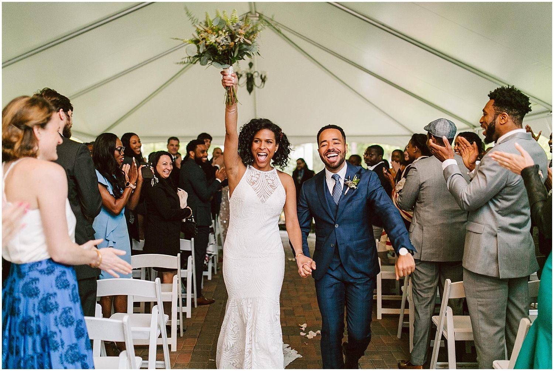 happy bride and groom exit ceremony