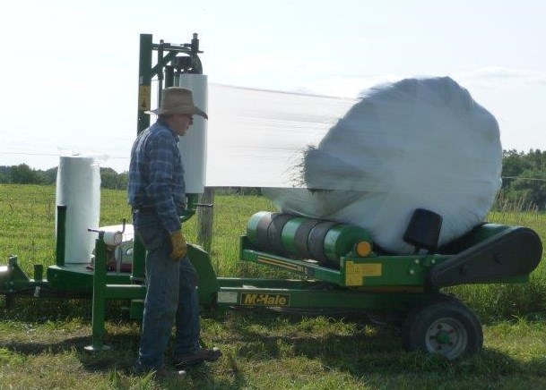 Step 4: Andy wraps the bales