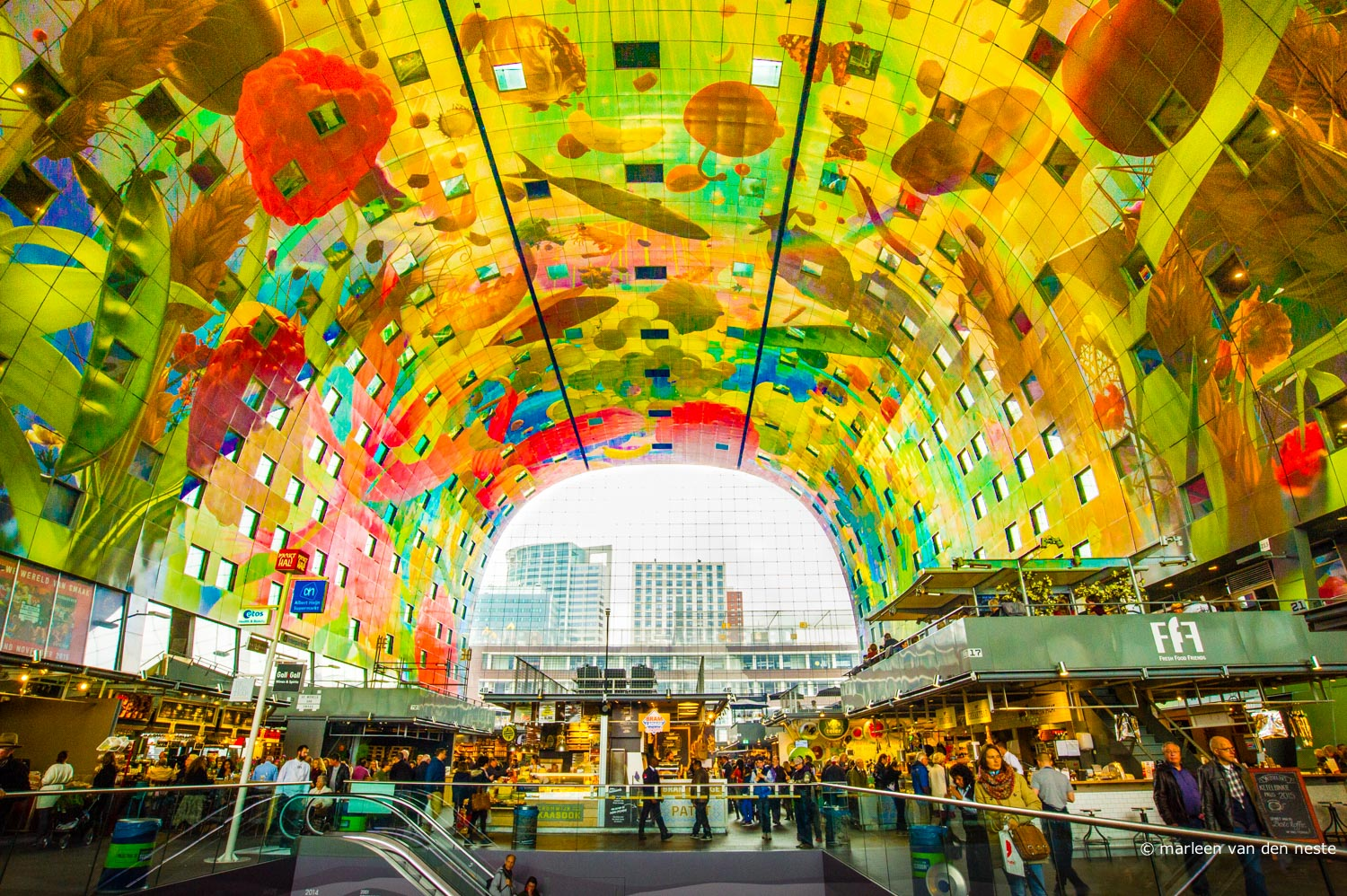 Ultra new market hall in Rotterdam.  The ceiling consists of 4000 painted panels, printed on metal sheets in the United States.