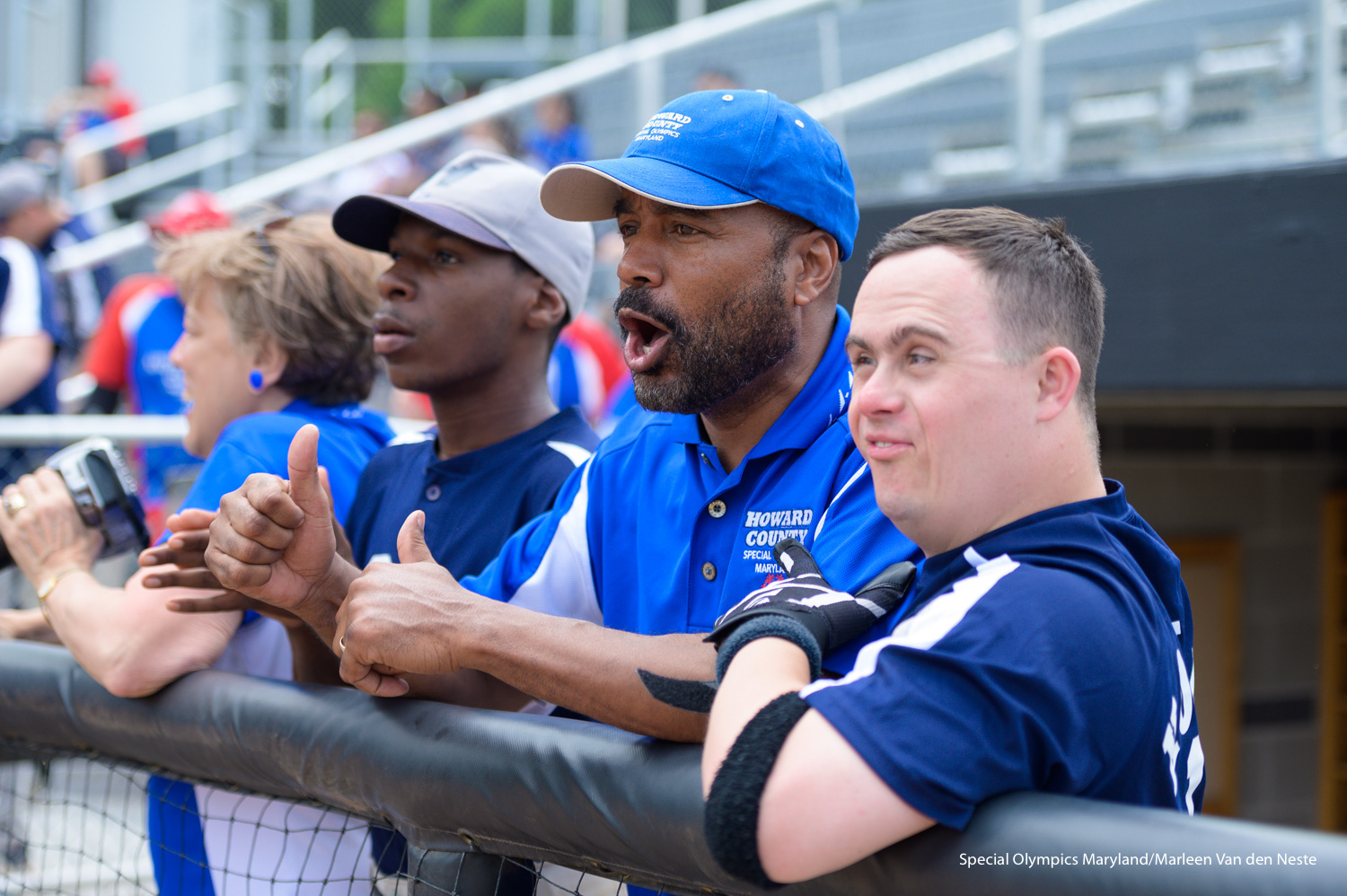 Howard County coaches and athlete watching the game from the sidelines at the Varsity Softball Field at Towson University on Sunday, June 9, 2019.