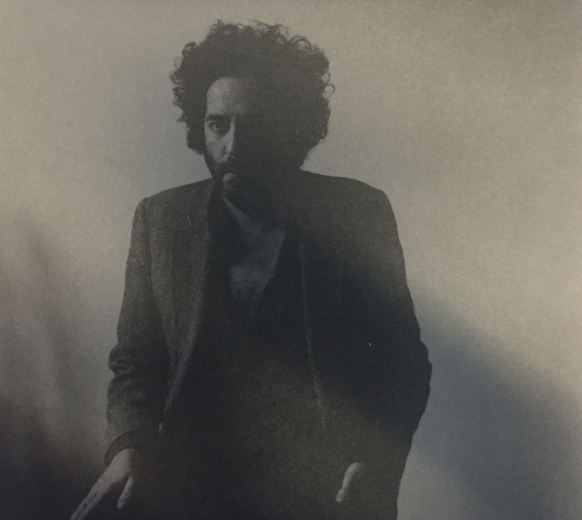 "The unwrapped album cover for Destroyer's ""Poison Season."""