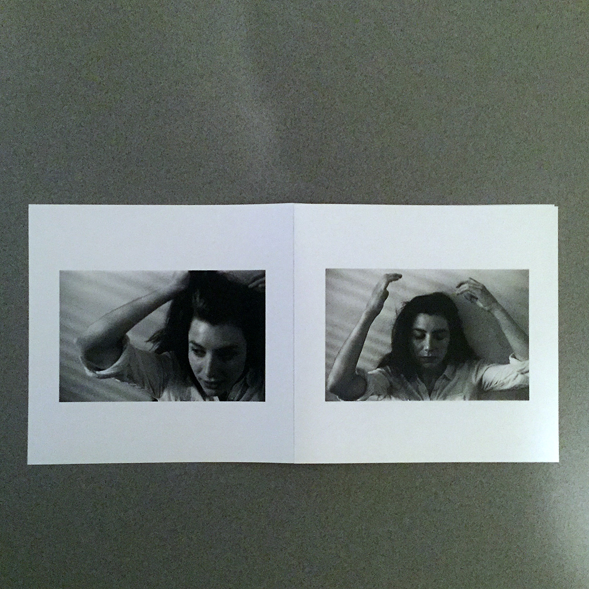 The quadfold liner notes includes stark black-and-white photography. These are the outside flaps.