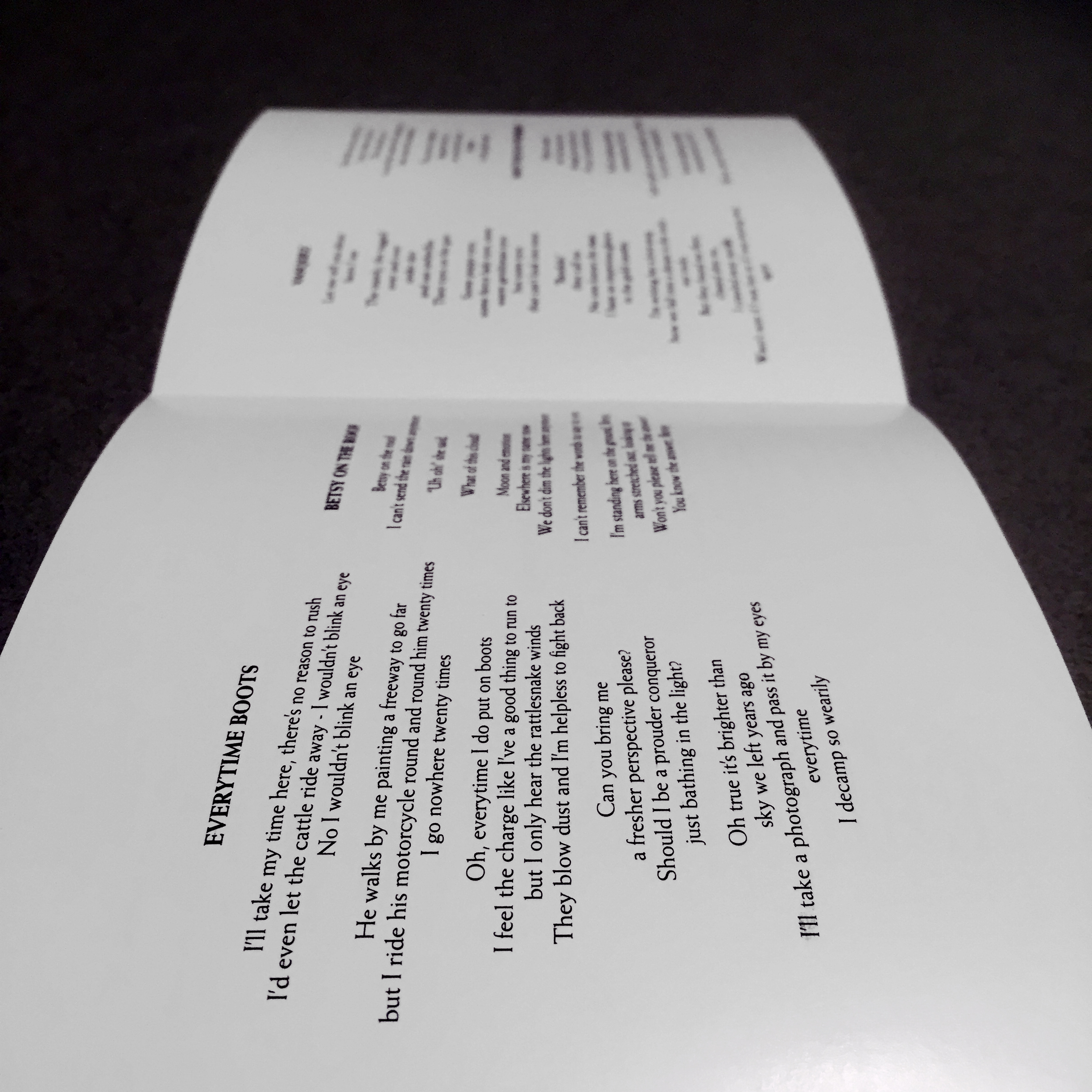The inside flaps of one side of the liner notes, with song titles and lyrics.